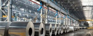 row of large steel rolls in a warehouse