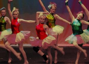 girls performing at a dance recital