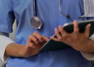 medical professional looking at chart