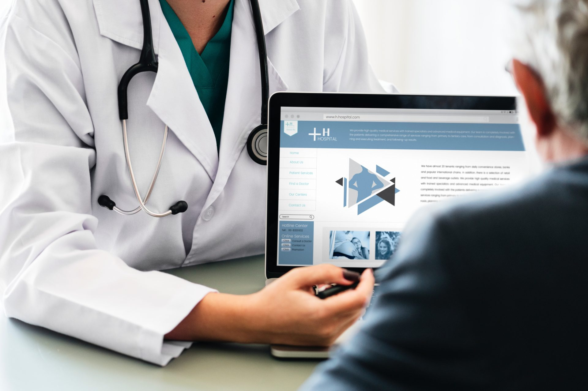 doctor explaining something to a patient on a laptop computer