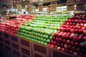 grocery store display of red and green apples